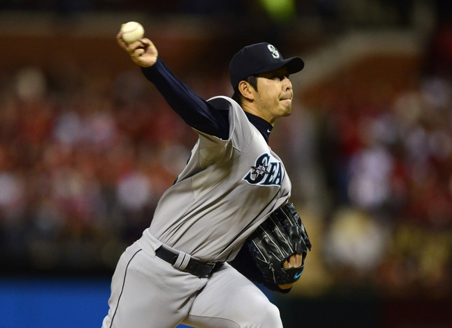 Sep 13, 2013; St. Louis, MO, USA; Seattle Mariners starting pitcher Hisashi Iwakuma (18) throws to a St. Louis Cardinals batter during the second inning at Busch Stadium. Mandatory Credit: Jeff Curry-USA TODAY Sports