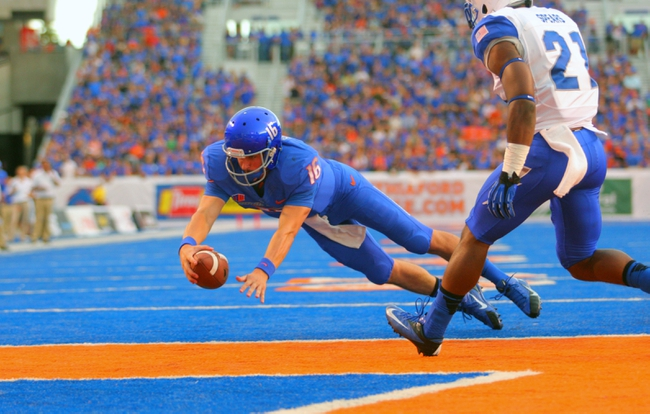 Sep 13, 2013; Boise, ID, USA; Boise State Broncos quarterback Joe Southwick (16) dives into the end zone for a touchdown during the first half against the Air Force Falcons at Bronco Stadium. Mandatory Credit: Brian Losness-USA TODAY Sports