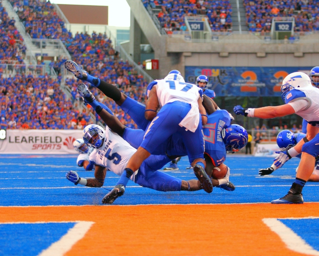 Sep 13, 2013; Boise, ID, USA; Boise State Broncos wide receiver Geraldo Boldewijn (17) is upended at the goal line by Air Force Falcons defensive back Dexter Walker (5) and defensive back Jamal Byrd (17) during the first half against the Air Force Falcons at Bronco Stadium. Mandatory Credit: Brian Losness-USA TODAY Sports