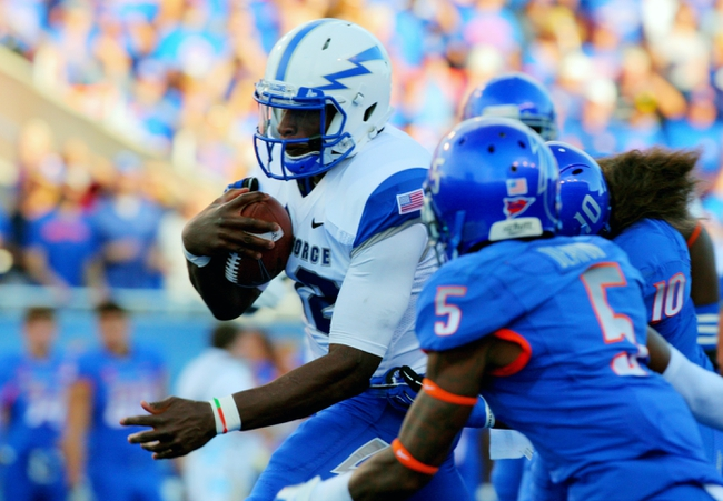 Sep 13, 2013; Boise, ID, USA; Air Force Falcons quarterback Jaleel Awini (12) runs for a first down during the first half against the Boise State Broncos at Bronco Stadium. Mandatory Credit: Brian Losness-USA TODAY Sports