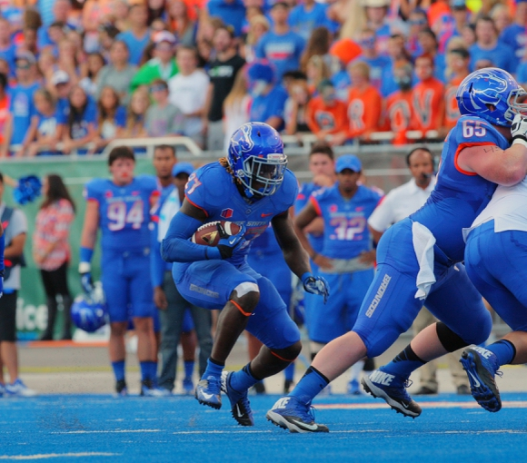 Sep 13, 2013; Boise, ID, USA; Boise State Broncos running back Jay Ajayi (27) runs for a gain during the first half against the Air Force Falcons at Bronco Stadium. Mandatory Credit: Brian Losness-USA TODAY Sports