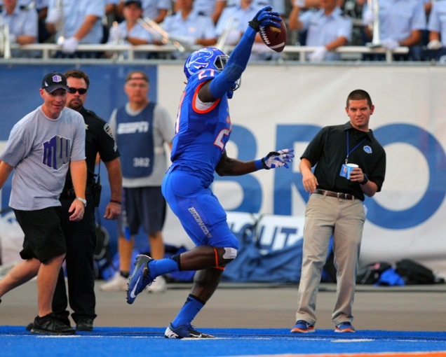 Sep 13, 2013; Boise, ID, USA; Boise State Broncos running back Jay Ajayi (27) scores a touchdown during the first half against the Air Force Falcons at Bronco Stadium. Mandatory Credit: Brian Losness-USA TODAY Sports