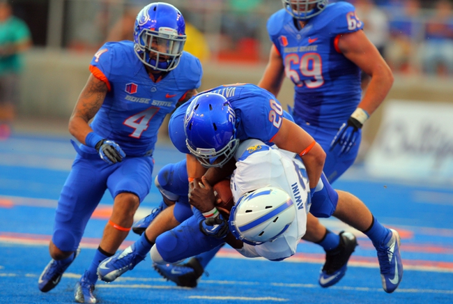 Sep 13, 2013; Boise, ID, USA; Air Force Falcons quarterback Jaleel Awini (12) is tackled by Boise State Broncos linebacker Tanner Vallejo (20) during the first half at Bronco Stadium. Mandatory Credit: Brian Losness-USA TODAY Sports