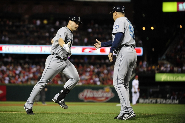 Sep 13, 2013; St. Louis, MO, USA; Seattle Mariners catcher Mike Zunino (3) is congratulated by coach Daren Brown (52) after hitting a solo home run off of St. Louis Cardinals starting pitcher Adam Wainwright (not pictured) during the fifth inning at Busch Stadium. Mandatory Credit: Jeff Curry-USA TODAY Sports
