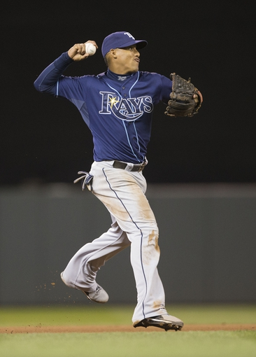Sep 13, 2013; Minneapolis, MN, USA; Tampa Bay Rays shortstop Yunel Escobar (11) throws the ball to first base in the fourth inning against the Minnesota Twins at Target Field. Mandatory Credit: Jesse Johnson-USA TODAY Sports