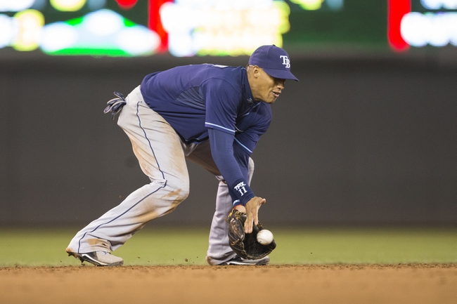 Sep 13, 2013; Minneapolis, MN, USA; Tampa Bay Rays shortstop Yunel Escobar (11) fields a ground ball in the sixth inning against the Minnesota Twins at Target Field. Mandatory Credit: Jesse Johnson-USA TODAY Sports