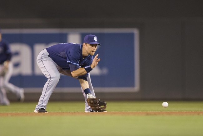 Sep 13, 2013; Minneapolis, MN, USA; Tampa Bay Rays second baseman Ben Zobrist (18) fields a ground ball in the sixth inning against the Tampa Bay Rays at Target Field. Mandatory Credit: Jesse Johnson-USA TODAY Sports
