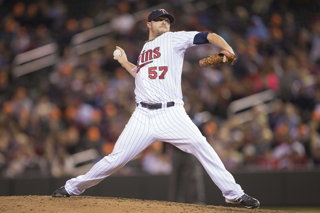 Sep 13, 2013; Minneapolis, MN, USA; Minnesota Twins relief pitcher Ryan Pressly (57) delivers a pitch in the eighth inning against the Tampa Bay Rays at Target Field. The Rays won 3-0. Mandatory Credit: Jesse Johnson-USA TODAY Sports