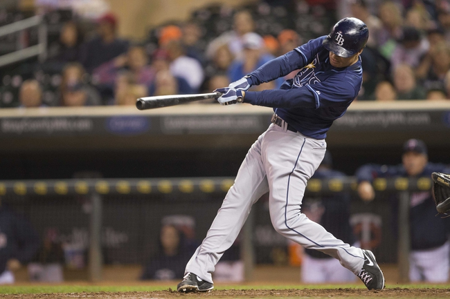 Sep 13, 2013; Minneapolis, MN, USA; Tampa Bay Rays left fielder Kelly Johnson (2) hits a single in the eighth inning against the Minnesota Twins at Target Field. The Rays won 3-0. Mandatory Credit: Jesse Johnson-USA TODAY Sports
