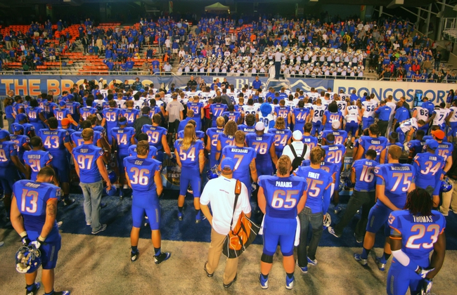 Sep 13, 2013; Boise, ID, USA; The Boise State Broncos and the Air Force Falcons pay their respects to the Air Force school song at the conclusion of the game at Bronco Stadium. Boise State defeated the Air Force 42-20. Mandatory Credit: Brian Losness-USA TODAY Sports