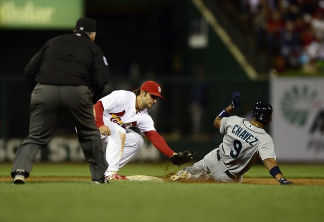 Sep 13, 2013; St. Louis, MO, USA; St. Louis Cardinals shortstop Pete Kozma (38) tags out Seattle Mariners pinch runner Endy Chavez (9) as he tries to steal second during the ninth inning at Busch Stadium. St. Louis defeated Seattle 2-1 in 10 innings. Mandatory Credit: Jeff Curry-USA TODAY Sports