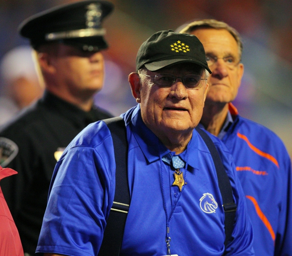 Sep 13, 2013; Boise, ID, USA; Marine Corps Congressional Medal of Honor recipient Art Jackson is honored during the second half between the Air Force Falcons and the Boise State Broncos at Bronco Stadium. Mr Jackson received the metal for his service during World War II.  Boise State defeated the Air Force 42-20. Mandatory Credit: Brian Losness-USA TODAY Sports