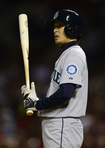 Sep 13, 2013; St. Louis, MO, USA; Seattle Mariners starting pitcher Hisashi Iwakuma (18) bats during the fifth inning against the St. Louis Cardinals at Busch Stadium. St. Louis defeated Seattle 2-1 in 10 innings. Mandatory Credit: Jeff Curry-USA TODAY Sports
