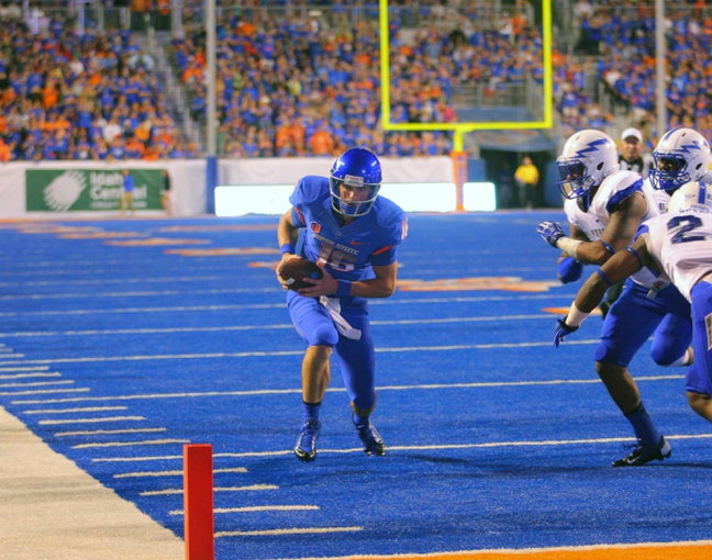 Sep 13, 2013; Boise, ID, USA; Boise State Broncos quarterback Joe Southwick (16) runs with the ball during the second half against the Air Force Falcons at Bronco Stadium. Boise State defeated the Air Force 42-20. Mandatory Credit: Brian Losness-USA TODAY Sports