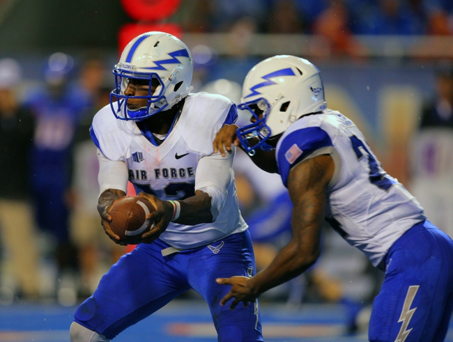 Sep 13, 2013; Boise, ID, USA; Air Force Falcons quarterback Jaleel Awini (12) fakes a handoff to  running back Jon Lee (24) during the second half against the Boise State Broncos at Bronco Stadium. Boise State defeated the Air Force 42-20. Mandatory Credit: Brian Losness-USA TODAY Sports