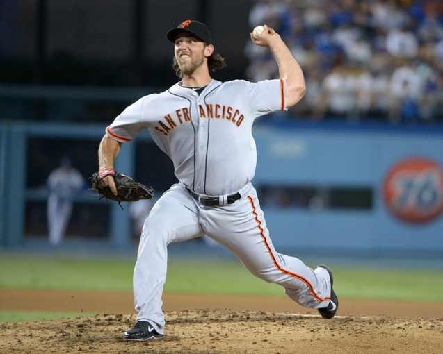 Sep 13, 2013; Los Angeles, CA, USA; San Francisco Giants starter Madison Bumgarner (40) delivers a pitch against the Los Angeles Dodgers at Dodger Stadium. Mandatory Credit: Kirby Lee-USA TODAY Sports