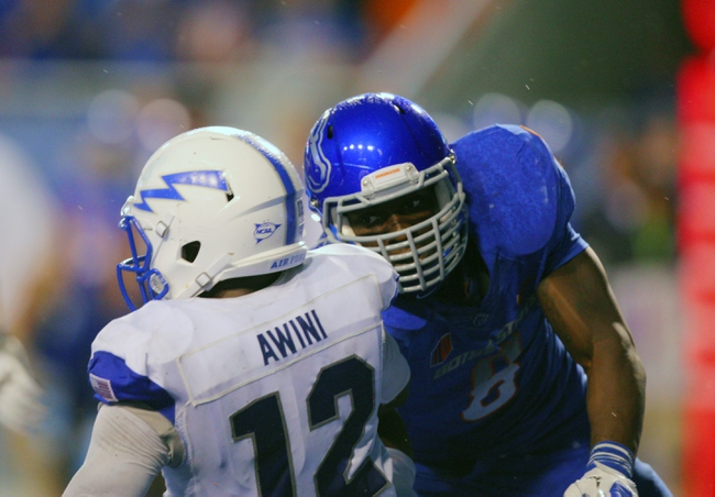 Sep 13, 2013; Boise, ID, USA; Boise State Broncos defensive end Demarcus Lawrence (8) tackles Air Force Falcons quarterback Jaleel Awini (12) during the second half at Bronco Stadium. Boise State defeated the Air Force 42-20. Mandatory Credit: Brian Losness-USA TODAY Sports