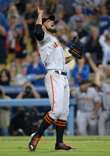 Sep 13, 2013; Los Angeles, CA, USA; San Francisco Giants reliever Sergio Romo (54) celebrates at the end of the game against the Los Angeles Dodgers at Dodger Stadium. The Giants defeated the Dodgers 4-2. Mandatory Credit: Kirby Lee-USA TODAY Sports