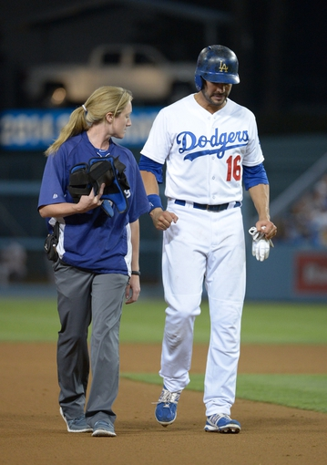 Sep 13, 2013; Los Angeles, CA, USA; Los Angeles Dodgers center fielder Andre Ethier (16) is assisted off the field by assistant athletic trainer Nancy Patterson Flynn after suffering an injury on a double in the eighth inning against the San Francisco Giants at Dodger Stadium. The Giants defeated the Dodgers 4-2. Mandatory Credit: Kirby Lee-USA TODAY Sports