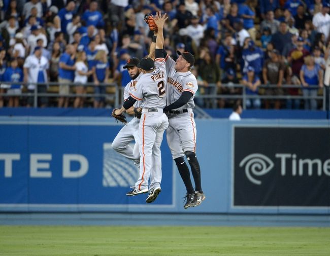 Sep 13, 2013; Los Angeles, CA, USA; San Francisco Giants outfielders Angel Pagan (left), Juan Perez (2) and Hunter Pence leap in celebration at the end of the game against the Los Angeles Dodgers at Dodger Stadium. The Giants defeated the Dodgers 4-2. Mandatory Credit: Kirby Lee-USA TODAY Sports