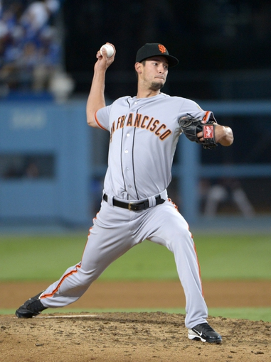 Sep 13, 2013; Los Angeles, CA, USA; San Francisco Giants reliever Jake Dunning delivers a pitch in the seventh inning against the Los Angeles Dodgers at Dodger Stadium. The Giants defeated the Dodgers 4-2. Mandatory Credit: Kirby Lee-USA TODAY Sports