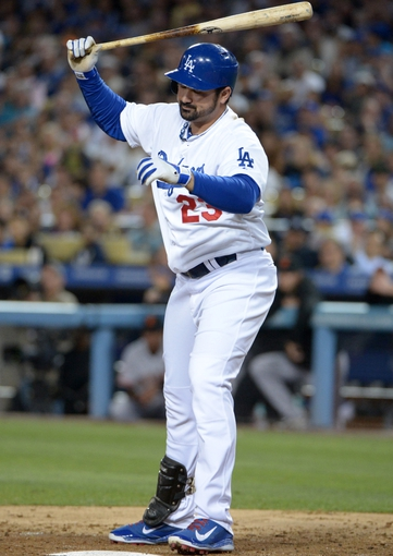 Sep 13, 2013; Los Angeles, CA, USA; Los Angeles Dodgers first baseman Adrian Gonzalez (23) reacts after striking out to end the seventh inning against the San Francisco Giants at Dodger Stadium. The Giants defeated the Dodgers 4-2. Mandatory Credit: Kirby Lee-USA TODAY Sports