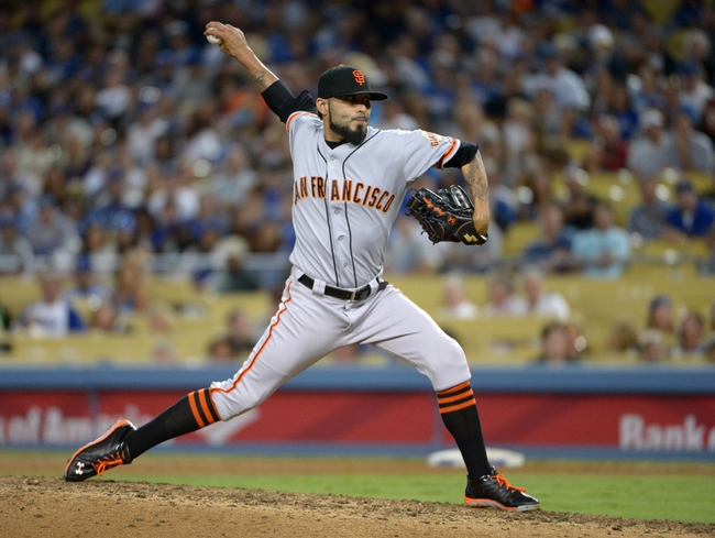Sep 13, 2013; Los Angeles, CA, USA; San Francisco Giants reliever Sergio Romo delivers a pitch against the Los Angeles Dodgers at Dodger Stadium. The Giants defeated the Dodgers 4-2. Mandatory Credit: Kirby Lee-USA TODAY Sports