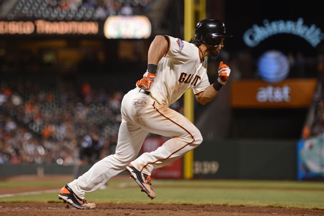 September 9, 2013; San Francisco, CA, USA; San Francisco Giants center fielder Angel Pagan (16) bats during the 10th inning against the Colorado Rockies at AT&T Park. The Giants defeated the Rockies 3-2 in 10 innings. Mandatory Credit: Kyle Terada-USA TODAY Sports