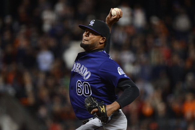 September 9, 2013; San Francisco, CA, USA; Colorado Rockies relief pitcher Manny Corpas (60) delivers a pitch during the ninth inning against the San Francisco Giants at AT&T Park. The Giants defeated the Rockies 3-2 in 10 innings. Mandatory Credit: Kyle Terada-USA TODAY Sports