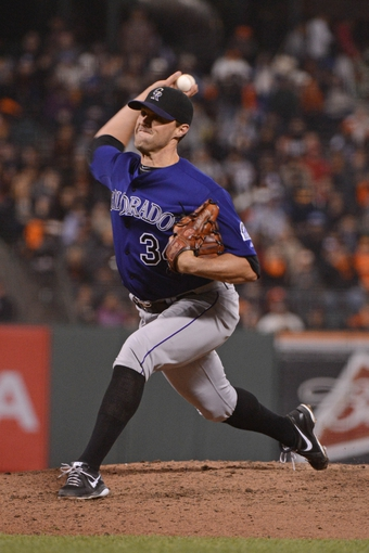 September 9, 2013; San Francisco, CA, USA; Colorado Rockies relief pitcher Matt Belisle (34) delivers a pitch during the eighth inning against the San Francisco Giants at AT&T Park. The Giants defeated the Rockies 3-2 in 10 innings. Mandatory Credit: Kyle Terada-USA TODAY Sports
