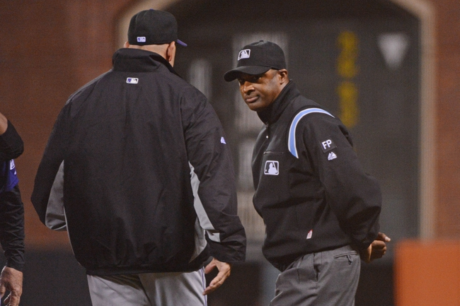 September 9, 2013; San Francisco, CA, USA; MLB umpire Alan Porter (64, right) listens to Colorado Rockies manager Walt Weiss (22, left) during the 10th inning against the San Francisco Giants at AT&T Park. The Giants defeated the Rockies 3-2 in 10 innings. Mandatory Credit: Kyle Terada-USA TODAY Sports