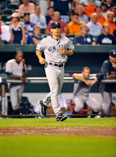 Sep 11, 2013; Baltimore, MD, USA; New York Yankees manager Joe Girardi (28) during the ninth inning against the Baltimore Orioles at Oriole Park at Camden Yards. The Yankees defeated the Orioles 5-4. Mandatory Credit: Joy R. Absalon-USA TODAY Sports