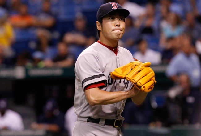 Sep 11, 2013; St. Petersburg, FL, USA; Boston Red Sox relief pitcher Koji Uehara (19) reacts and claps his hands after he pitched the ninth inning against the Tampa Bay Rays  at Tropicana Field. Boston Red Sox defeated the Tampa Bay Rays 7-3. Mandatory Credit: Kim Klement-USA TODAY Sports