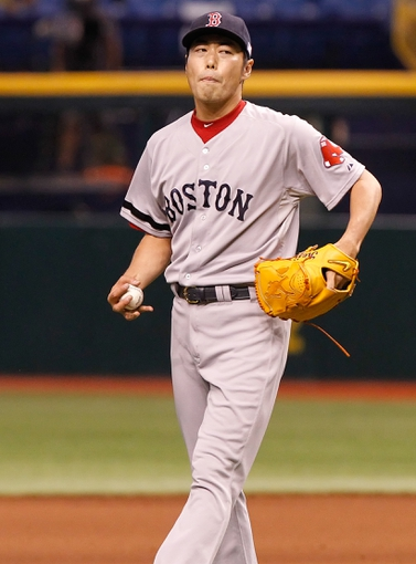 Sep 11, 2013; St. Petersburg, FL, USA; Boston Red Sox relief pitcher Koji Uehara (19) against the Tampa Bay Rays at Tropicana Field. Boston Red Sox defeated the Tampa Bay Rays 7-3. Mandatory Credit: Kim Klement-USA TODAY Sports