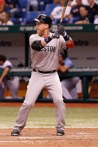 Sep 11, 2013; St. Petersburg, FL, USA; Boston Red Sox left fielder Mike Carp (37) at bat against the Tampa Bay Rays at Tropicana Field. Boston Red Sox defeated the Tampa Bay Rays 7-3. Mandatory Credit: Kim Klement-USA TODAY Sports