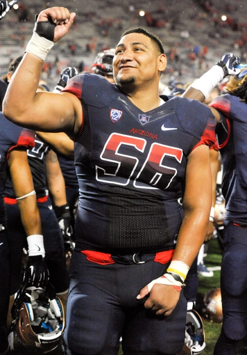 Aug 30, 2013; Tucson, AZ, USA; Arizona Wildcats offensive lineman Steven Gurrola (56) sings Bear Down with his teammates after the fourth quarter against the Northern Arizona Lumberjacks at Arizona Stadium. Arizona beat Northern Arizona 35-0. Mandatory Credit: Casey Sapio-USA TODAY Sports