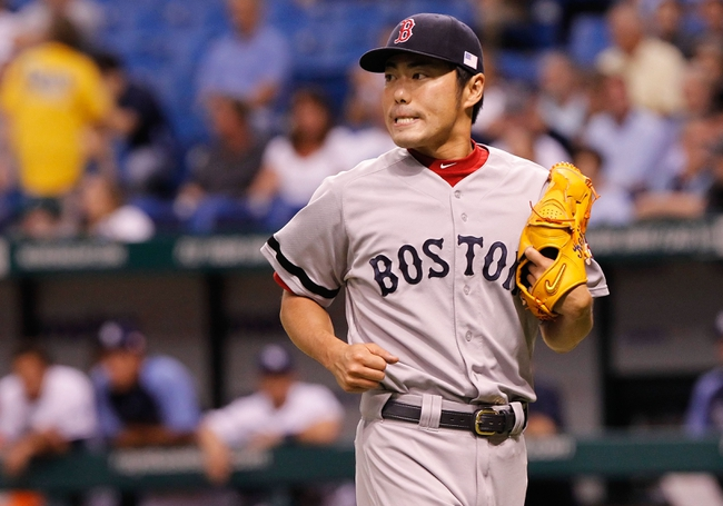 Sep 11, 2013; St. Petersburg, FL, USA; Boston Red Sox relief pitcher Koji Uehara (19) reacts after he pitched the ninth inning against the Tampa Bay Rays  at Tropicana Field. Boston Red Sox defeated the Tampa Bay Rays 7-3. Mandatory Credit: Kim Klement-USA TODAY Sports