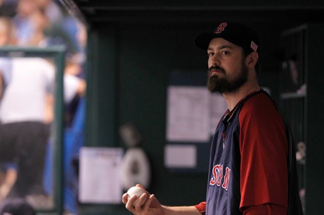 Sep 11, 2013; St. Petersburg, FL, USA;Boston Red Sox relief pitcher Andrew Miller (30) in the dugout against the Tampa Bay Rays at Tropicana Field. Boston Red Sox defeated the Tampa Bay Rays 7-3. Mandatory Credit: Kim Klement-USA TODAY Sports