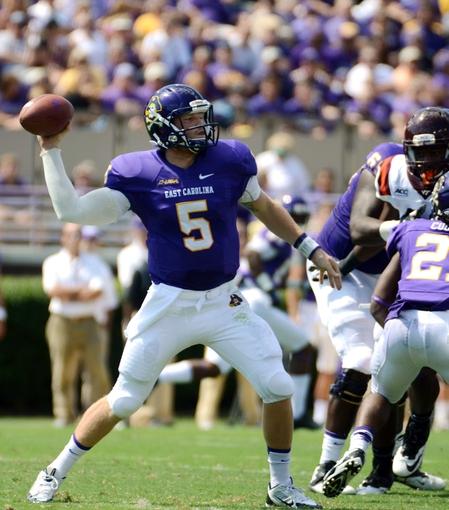 Sep 14, 2013; Greenville, NC, USA; East Carolina Pirates quarterback Shane Carden (5) passes against the Virginia Tech Hokies at Dowdy-Ficklen Stadium. Mandatory Credit: Rob Kinnan-USA TODAY Sports