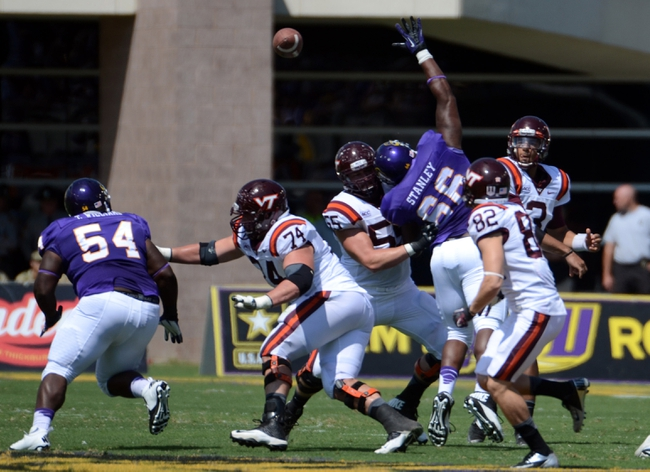 Sep 14, 2013; Greenville, NC, USA;  Virginia Tech Hokies quarterback Logan Thomas (3) throws over the outstretched hands of East Carolina Pirates nose tackle Terrell Stanley (66) during the first half at Dowdy-Ficklen Stadium. Mandatory Credit: Rob Kinnan-USA TODAY Sports