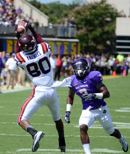 Sep 14, 2013; Greenville, NC, USA; Virginia Tech Hokies receiver Demitri Knowles (80) catches a touchdown pass ahead of East Carolina Pirates defensive back Adonis Armstrong (3) at Dowdy-Ficklen Stadium. Mandatory Credit: Rob Kinnan-USA TODAY Sports