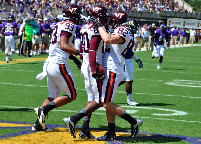 Sep 14, 2013; Greenville, NC, USA;  Virginia Tech Hokies receiver Demitri Knowles (80) is congratulated by teammate Willie Byrn (82) after a first half touchdown against the East Carolina Pirates at Dowdy-Ficklen Stadium. Mandatory Credit: Rob Kinnan-USA TODAY Sports