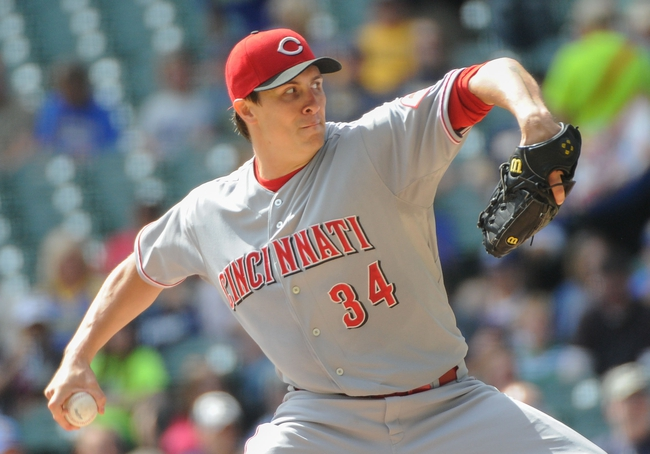Sep 14, 2013; Milwaukee, WI, USA; Cincinnati Reds pitcher Homer Bailey pitches in the first inning against the Milwaukee Brewers at Miller Park. Mandatory Credit: Benny Sieu-USA TODAY Sports