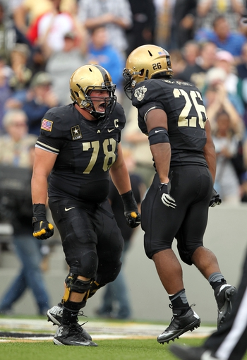 Sep 14, 2013; West Point, NY, USA; Army Black Knights offensive lineman Michael Kime (78) celebrates with running back Larry Dixon after scoring a touchdown at Michie Stadium. Mandatory Credit: Danny Wild-USA TODAY Sports