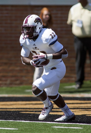 Sep 14, 2013; Winston-Salem, NC, USA; Louisiana Monroe Warhawks running back Cortney Davis (22) returns a kickoff during the first quarter against the Wake Forest Demon Deacons at BB&T Field. Mandatory Credit: Jeremy Brevard-USA TODAY Sports