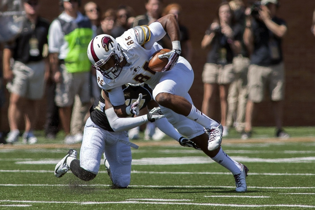 Sep 14, 2013; Winston-Salem, NC, USA; Louisiana Monroe Warhawks wide receiver Je'Ron Hamm (86) gets tackled by Wake Forest Demon Deacons cornerback Allen Ramsey (15) during the first quarter at BB&T Field. Mandatory Credit: Jeremy Brevard-USA TODAY Sports