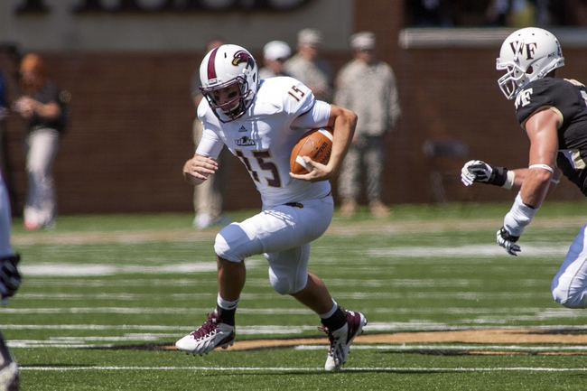 Sep 14, 2013; Winston-Salem, NC, USA; Louisiana Monroe Warhawks quarterback Kolton Browning (15) runs the ball during the first quarter against the Wake Forest Demon Deacons at BB&T Field. Mandatory Credit: Jeremy Brevard-USA TODAY Sports