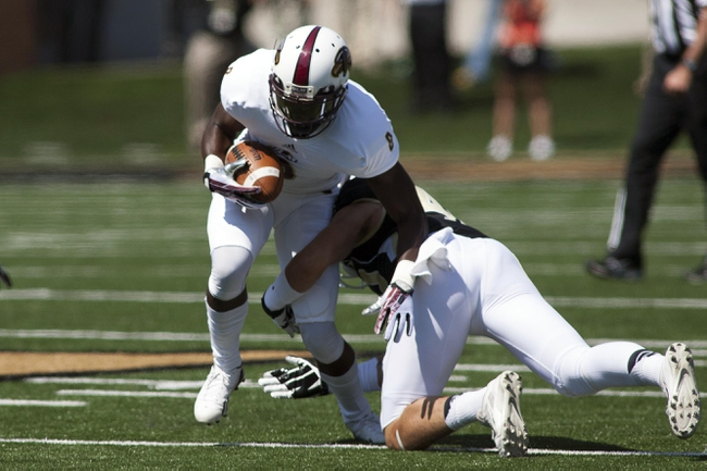 Sep 14, 2013; Winston-Salem, NC, USA; Louisiana Monroe Warhawks wide receiver Tavarese Maye (8) gets tackled by Wake Forest Demon Deacons linebacker Nick Karp (45) during the first quarter at BB&T Field. Mandatory Credit: Jeremy Brevard-USA TODAY Sports