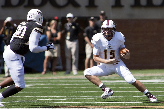 Sep 14, 2013; Winston-Salem, NC, USA; Louisiana Monroe Warhawks quarterback Kolton Browning (15) runs the ball while Wake Forest Demon Deacons defensive end Kristopher Redding (90) pursues during the first quarter at BB&T Field. Mandatory Credit: Jeremy Brevard-USA TODAY Sports