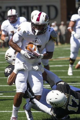 Sep 14, 2013; Winston-Salem, NC, USA; Louisiana Monroe Warhawks wide receiver Je'Ron Hamm (86) gets tackled by Wake Forest Demon Deacons safety A.J. Marshall (17) during the first quarter at BB&T Field. Mandatory Credit: Jeremy Brevard-USA TODAY Sports